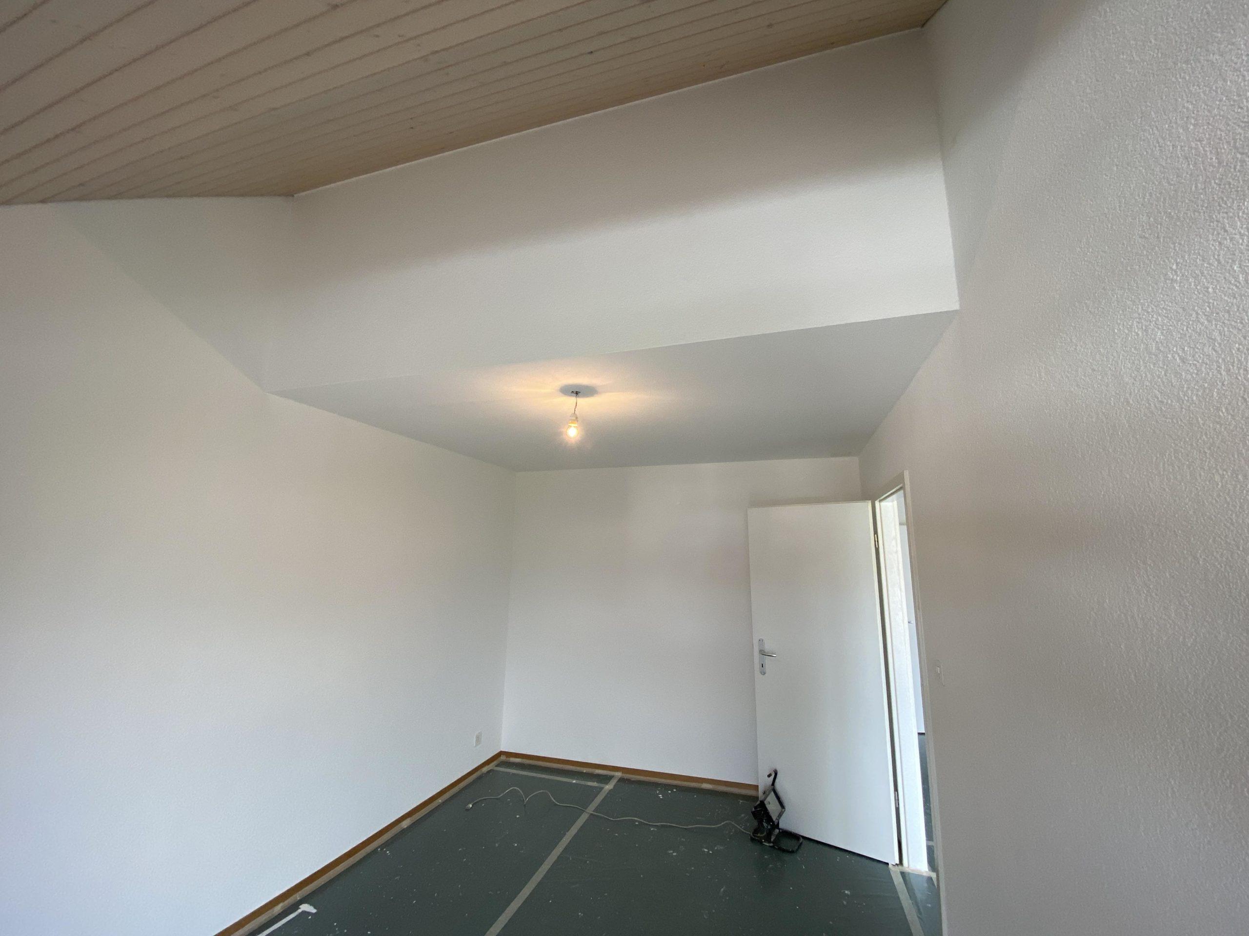 Rénovation en peinture des murs en crépi d'un appartement